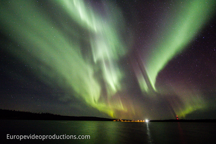 Northern lights over a lake in Finnish Lapland