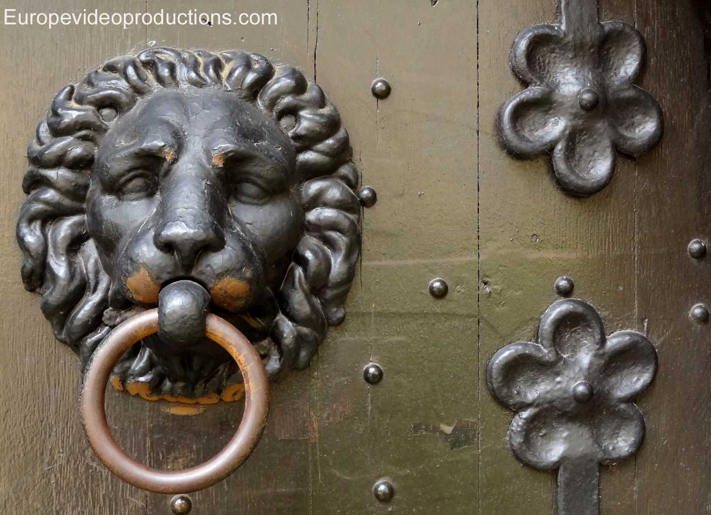 Door knocker in the medieval Beaufort Castle in Mullerthal region in Luxembourg