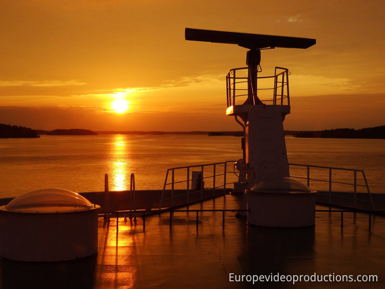 Sunset in the archipelago of Finland – photo taken from a ferry boat