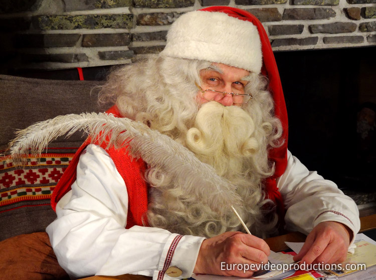 Santa Claus writing a letter in Santa's Office on the Arctic Circle in Rovaniemi, Finland